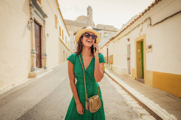 cheerful woman talking on her smartphone stock photo