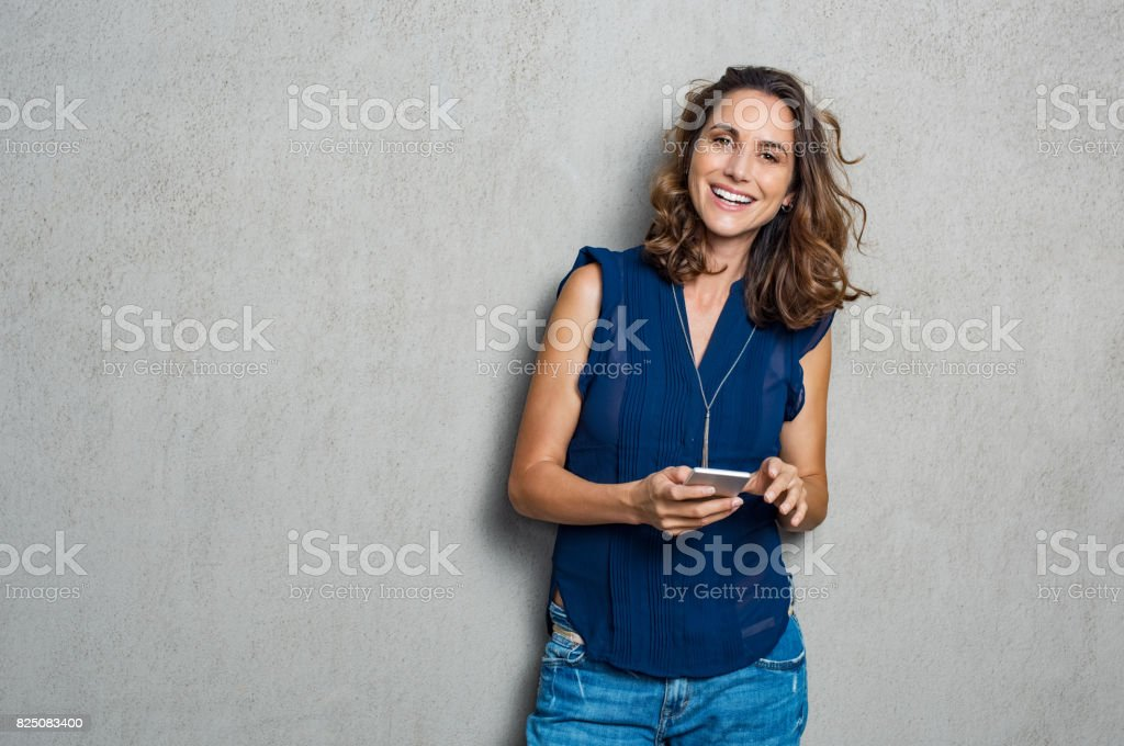Cheerful woman using phone