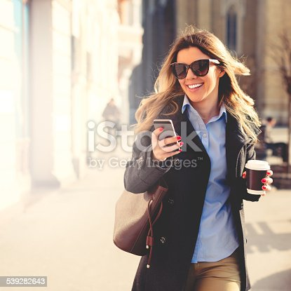 istock Cheerful woman using smart phone 539282643