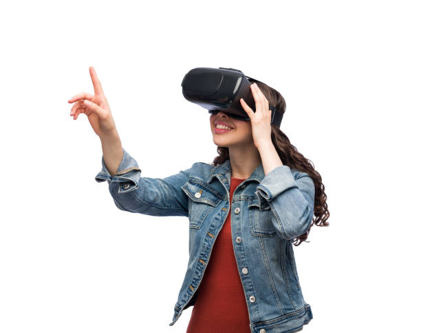 Cheerful woman using virtual reality glasses stock photo