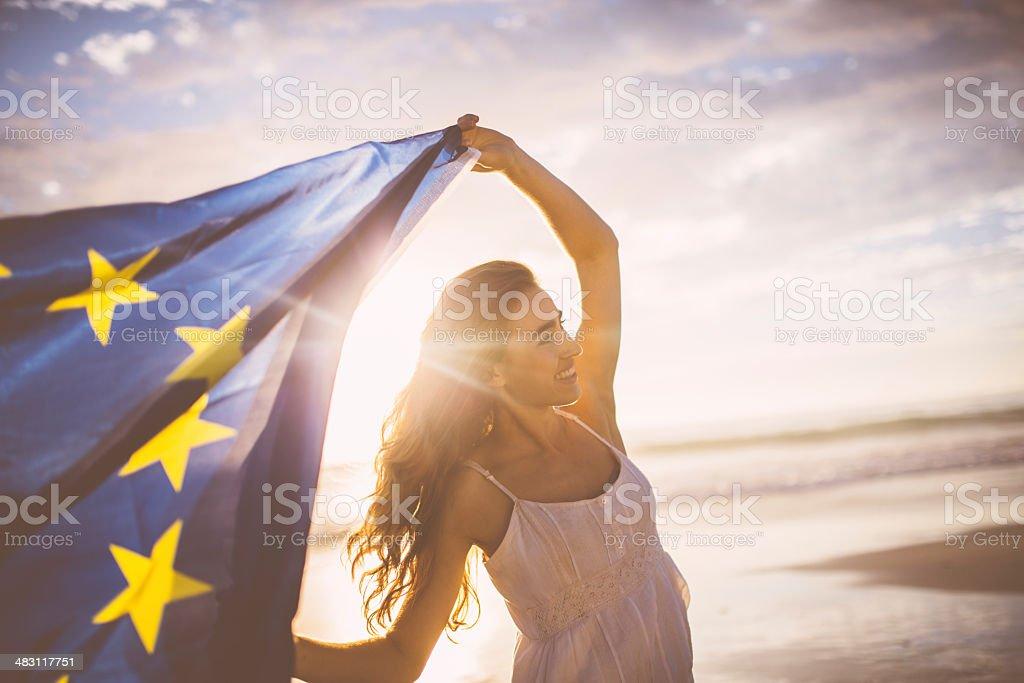 Cheerful woman waving european flag stock photo