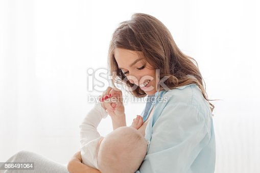 istock Cheerful woman with baby 866491064