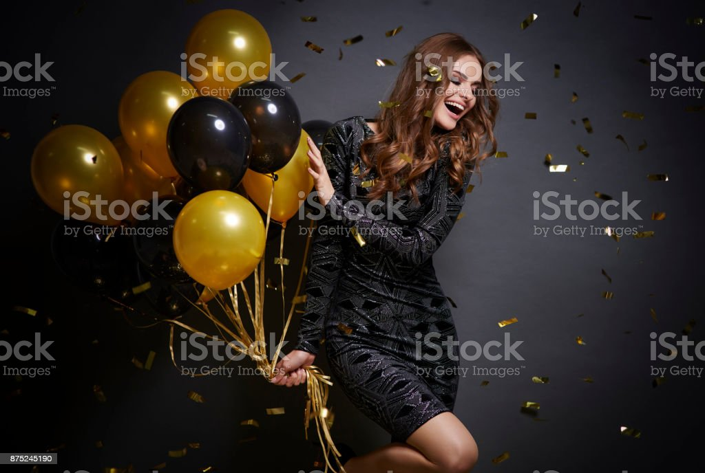 Cheerful woman with balloons laughing stock photo