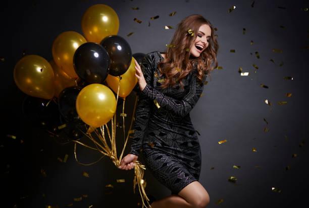 cheerful woman with balloons laughing - mulher balões imagens e fotografias de stock