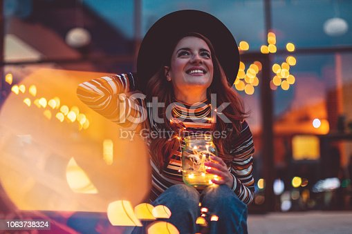 Cheerful woman with Christmas lights