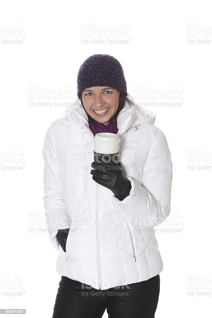 Cheerful woman with coffee and winter clothes. stock photo