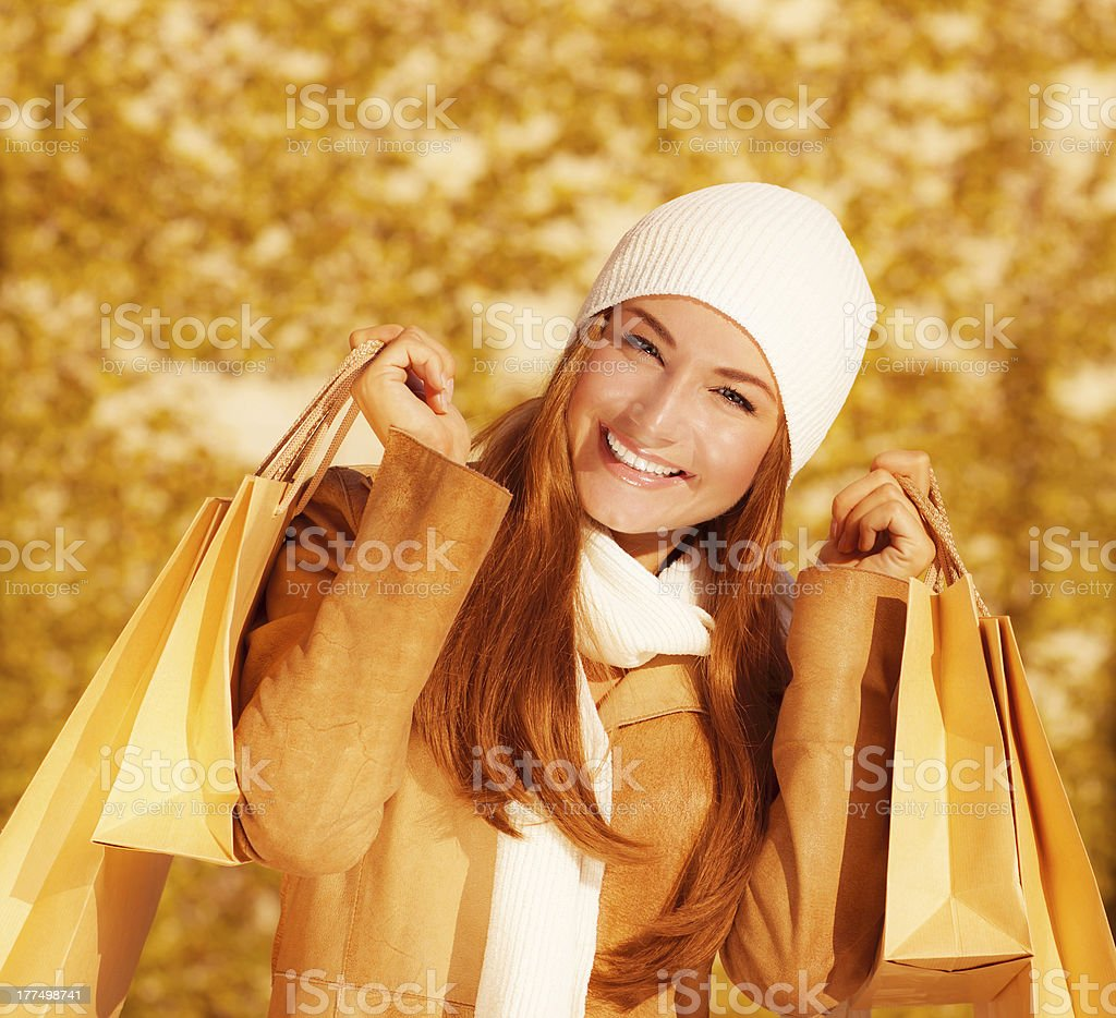 Cheerful woman with paper bags royalty-free stock photo