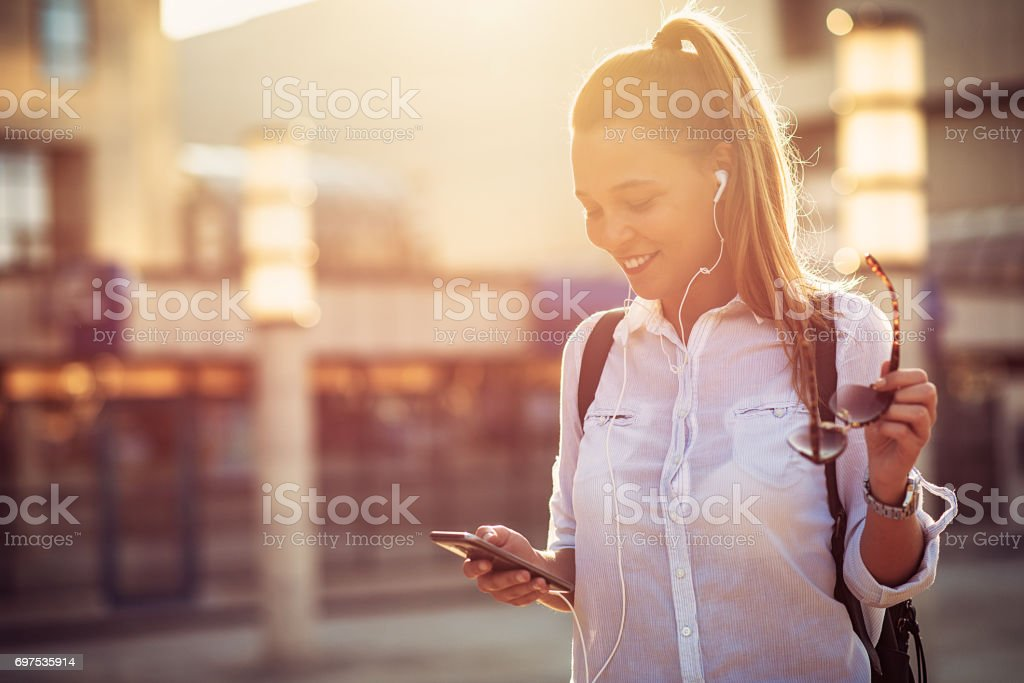 Cheerful woman with smartphone stock photo