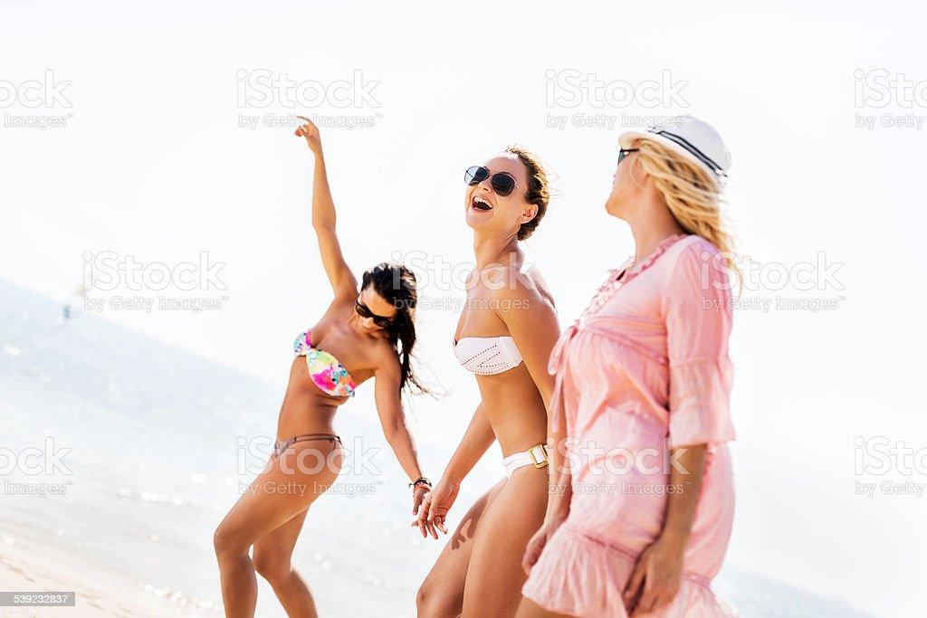 Cheerful women having fun on the beach. royalty-free stock photo