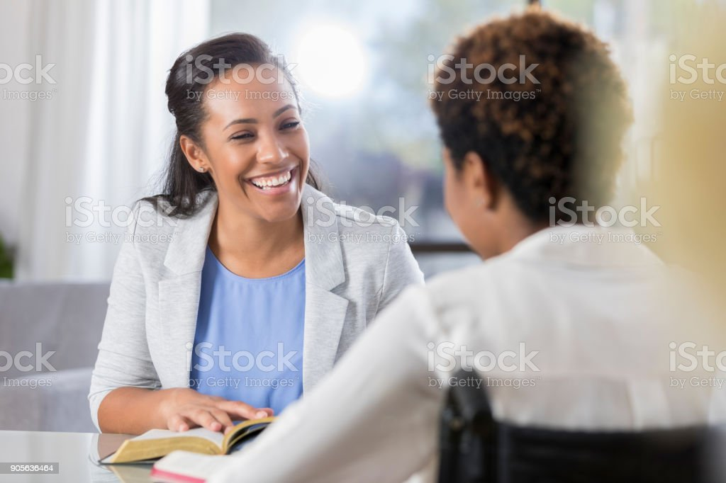 Cheerful women participate in Bible study stock photo