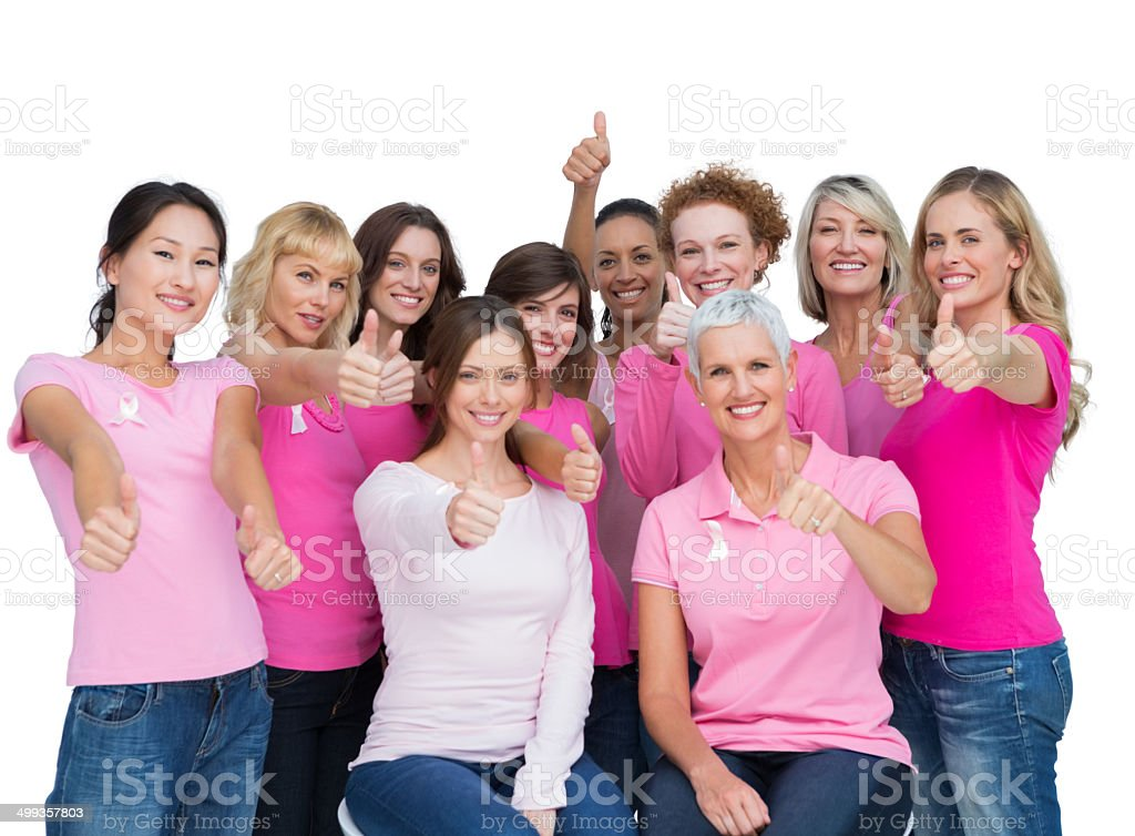Cheerful women posing and wearing pink for breast cancer stock photo