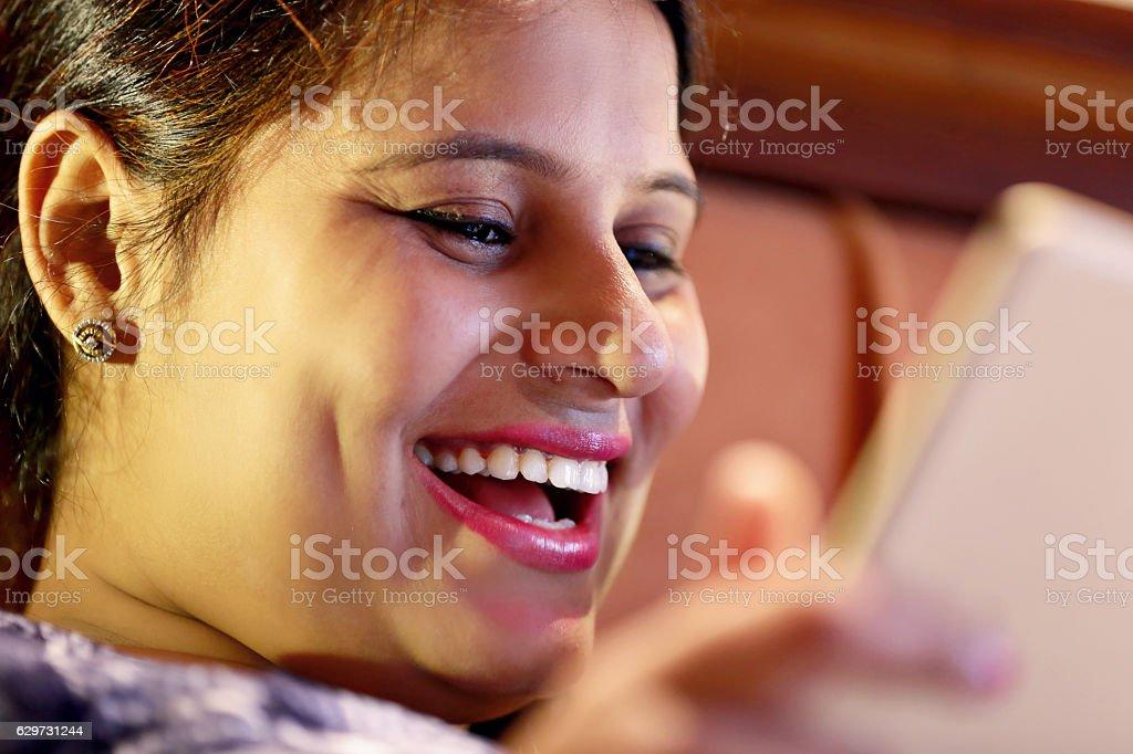 Cheerful women using ipad stock photo
