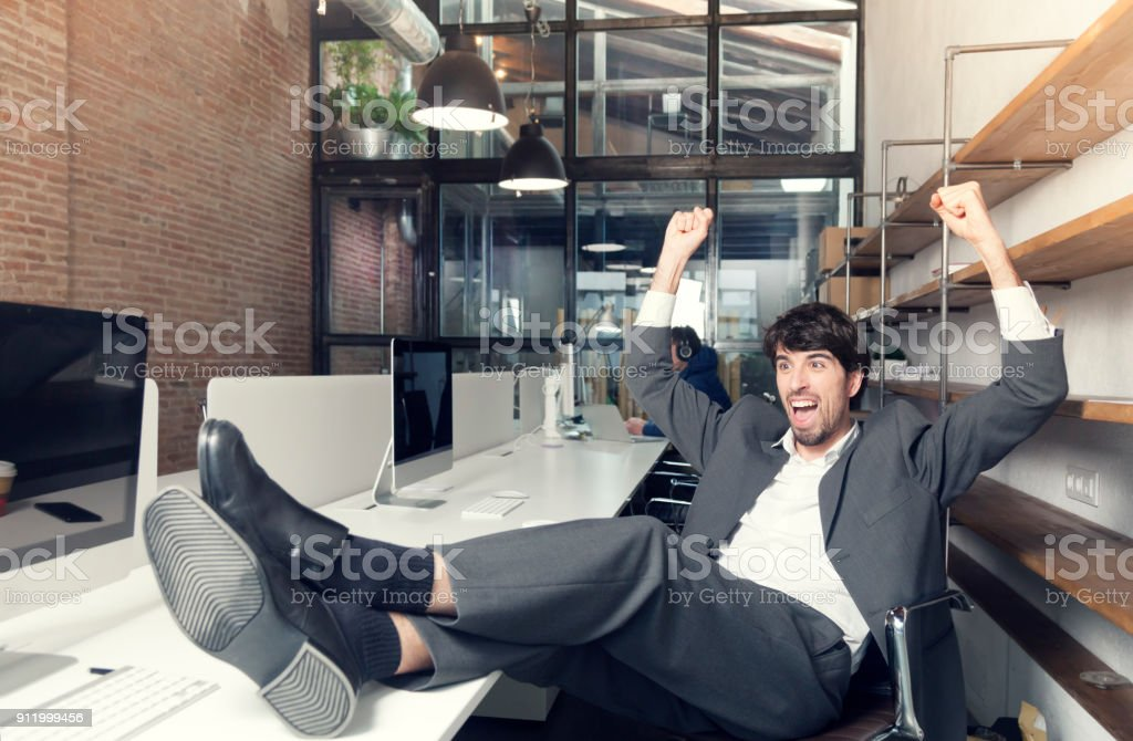 Cheerful worker celebrating good news stock photo