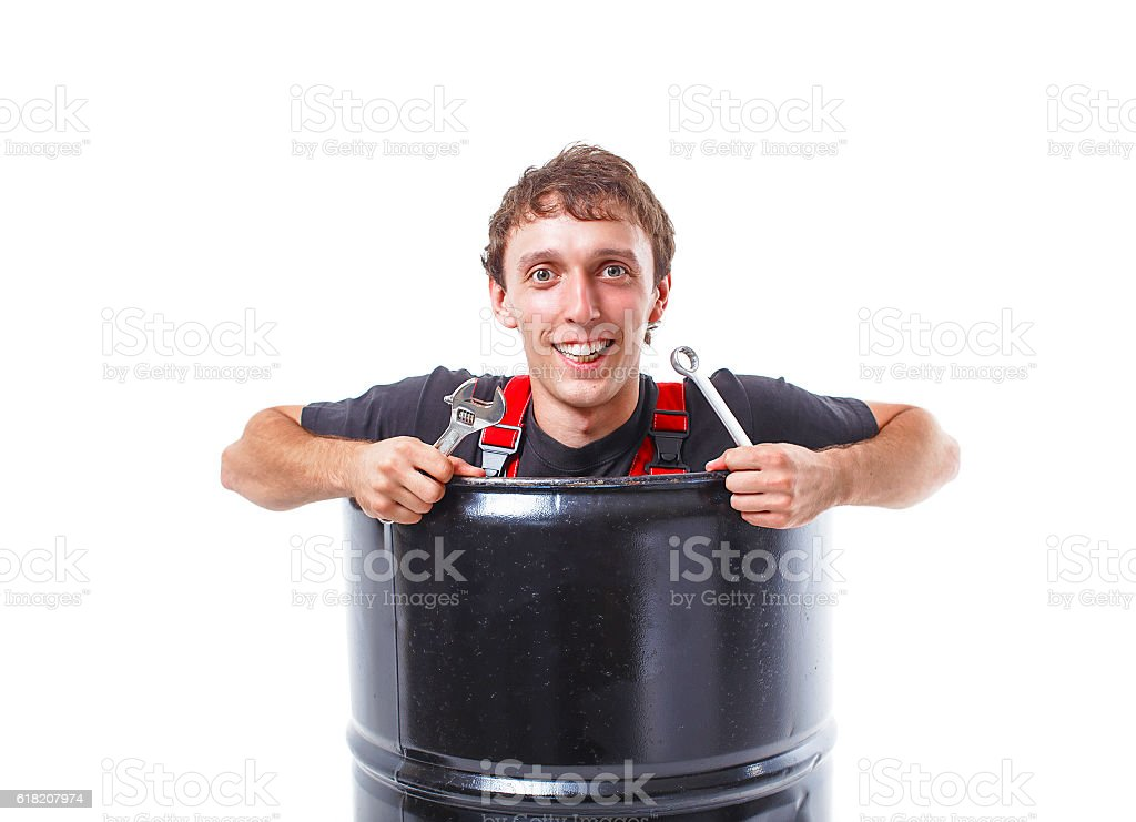 cheerful worker with a wrench in a black pipe stock photo