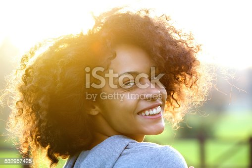 istock Cheerful young african american woman smiling outdoors 532957425