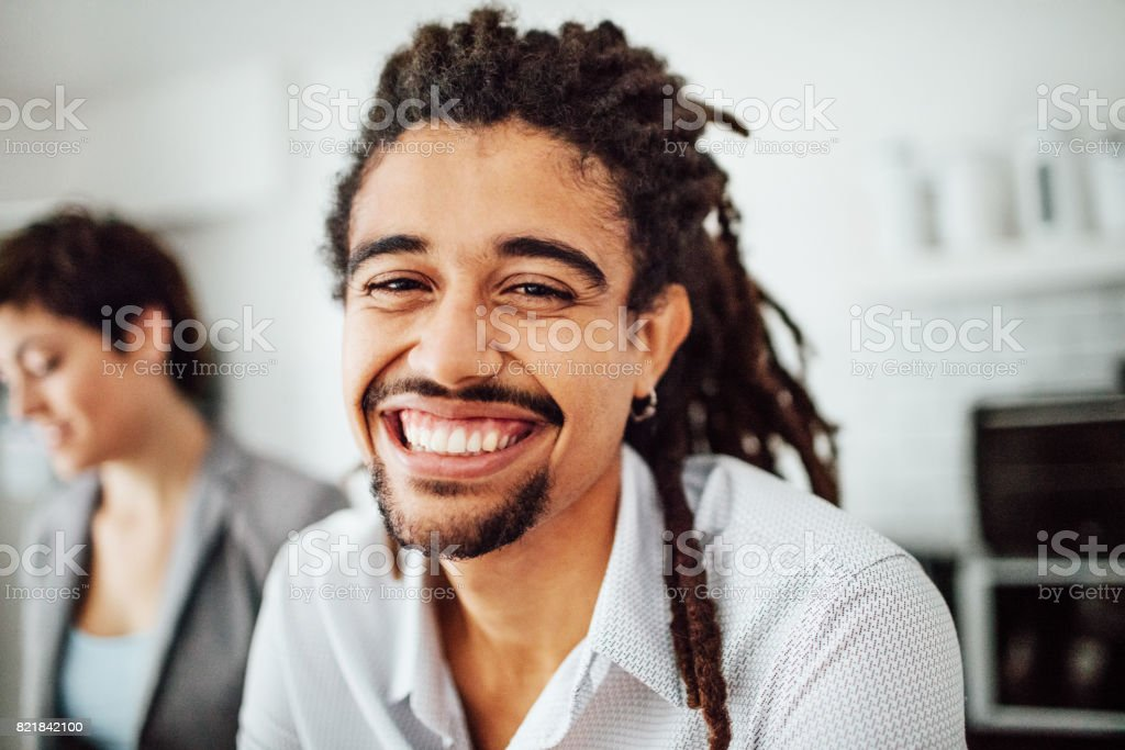 Cheerful young african man at startup stock photo