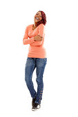 istock Cheerful young african woman standing on white 187119608