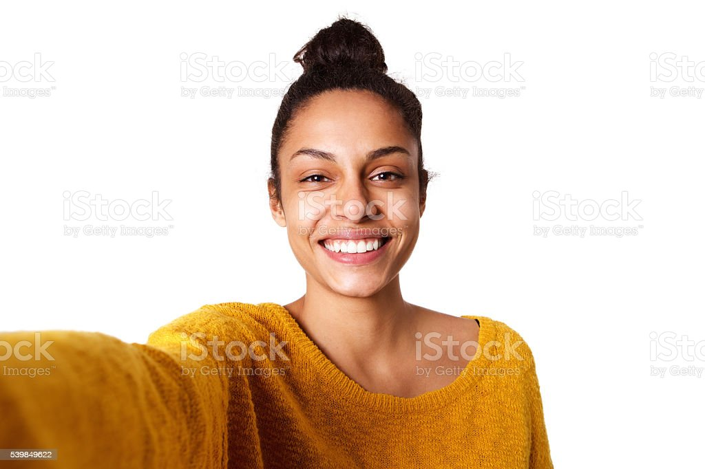 Cheerful young african woman taking selfie stock photo