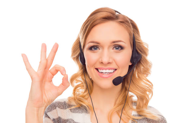 Cheerful young agent of call center gesturing