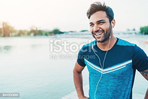 istock Cheerful young athlete outdoors by the river 944300692