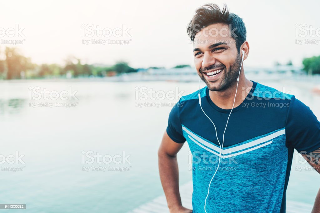 Cheerful young athlete outdoors by the river stock photo