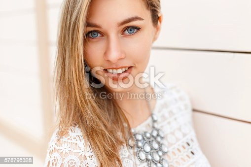 578791454istockphoto Cheerful young beautiful woman with a smile and blue eyes 578795328