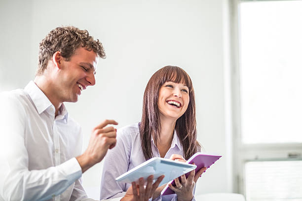 Cheerful young business people discussing together in office – Foto