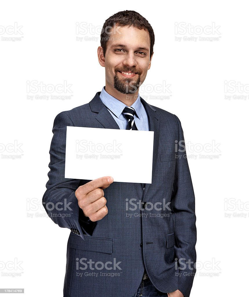 Cheerful young businessman showing small blank signboard royalty-free stock photo