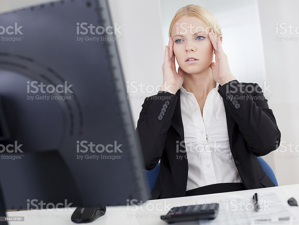 Cheerful young businesswoman with headache royalty-free stock photo