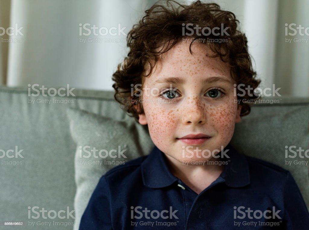 Cheerful young caucasian boy stock photo