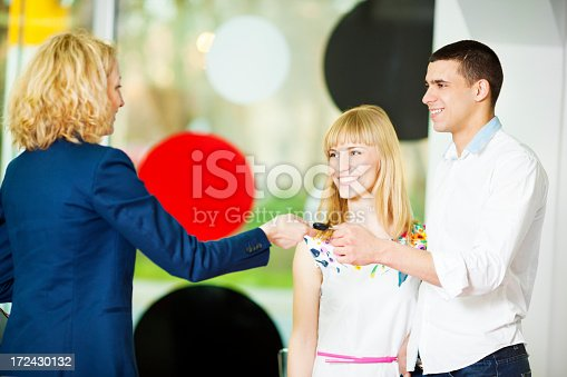 1178695243 istock photo Cheerful Young Couple Buying Car. 172430132