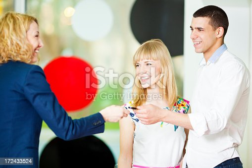 1178695243 istock photo Cheerful Young Couple Buying Car. 172433524