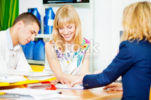 1178695243 istock photo Cheerful Young Couple Buying Car. 172438789