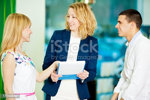 1178695243 istock photo Cheerful Young Couple Buying Car. 172445941