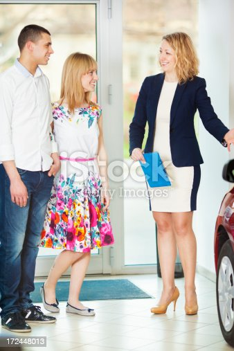 1178695243 istock photo Cheerful Young Couple Buying Car. 172448013