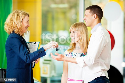1178695243 istock photo Cheerful Young Couple Buying Car. 172458594