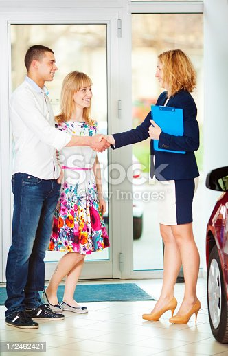 istock Cheerful Young Couple Buying Car. 172462421