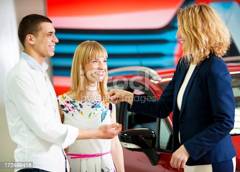 1178695243 istock photo Cheerful Young Couple Buying Car. 172466418