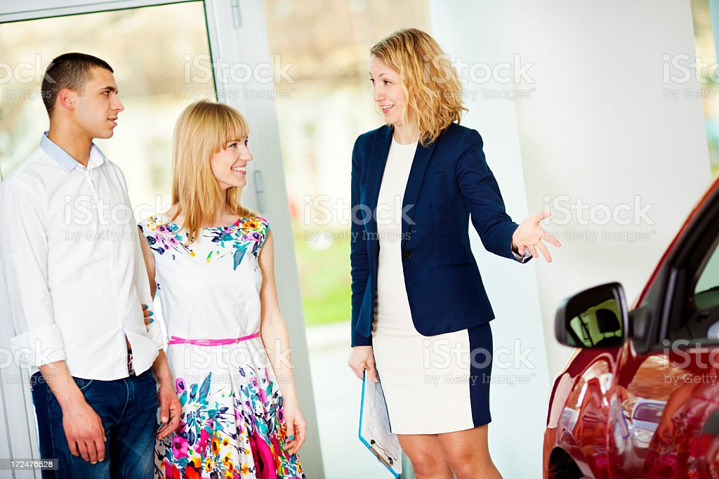 Cheerful Young Couple Buying Car. royalty-free stock photo
