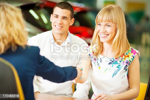 istock Cheerful Young Couple Buying Car. 172483318