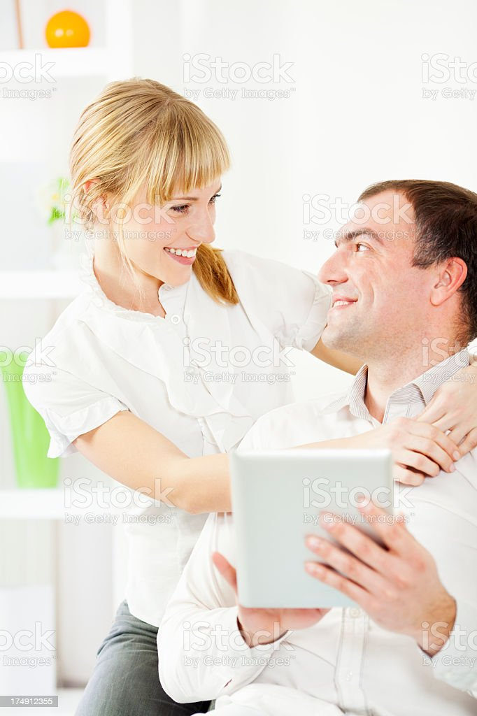 Cheerful Young Couple Having Fun With Digital Tablet. royalty-free stock photo