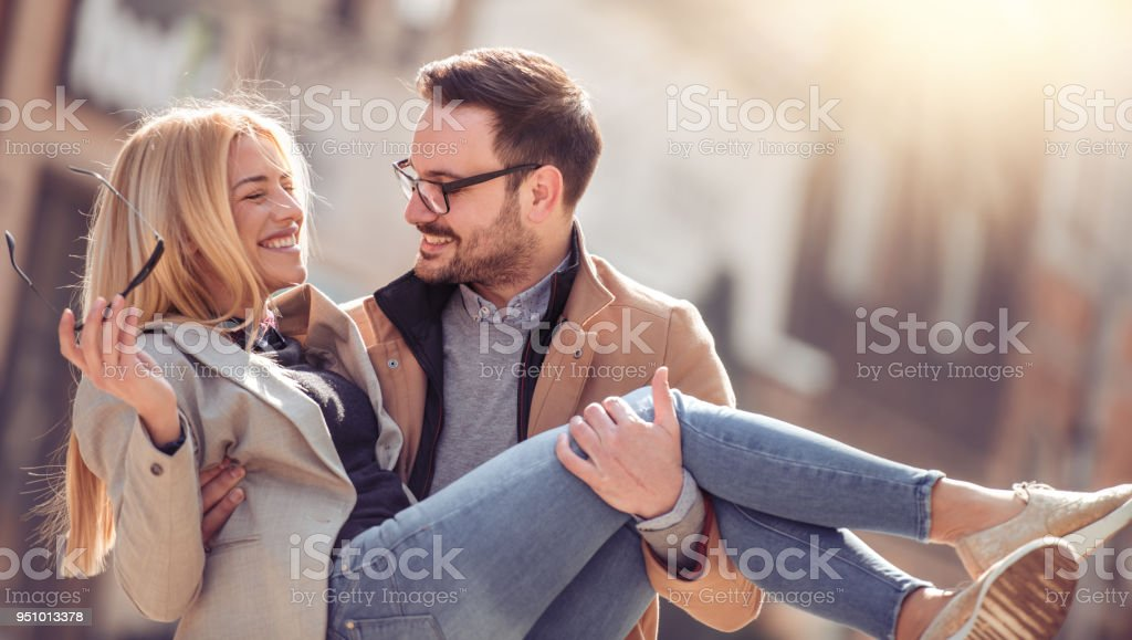 Cheerful young couple having great time in the city stock photo