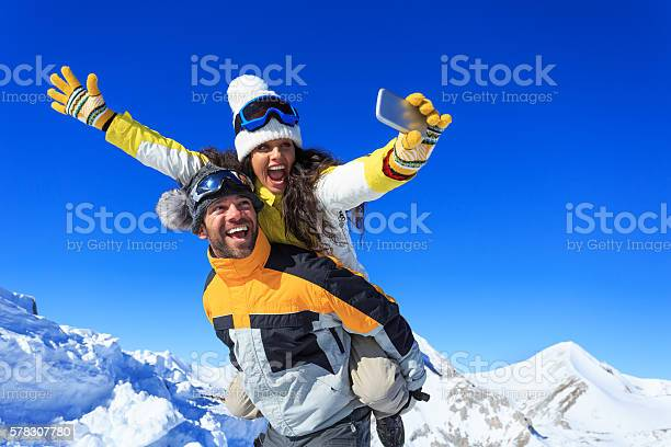 Cheerful young couple making winter selfie picture id578307780?b=1&k=6&m=578307780&s=612x612&h=rogsoquiskv 4gxykf u ayg6j3ww2wozesat6upuay=