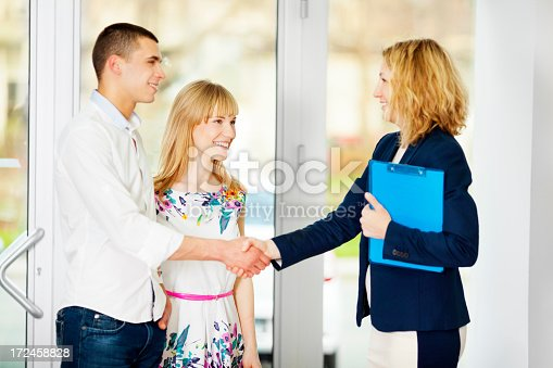 istock Cheerful Young Couple Meeting With Financial Advisor. 172458828