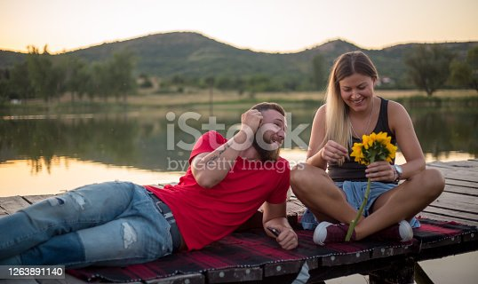 Young couple sitting on the dock