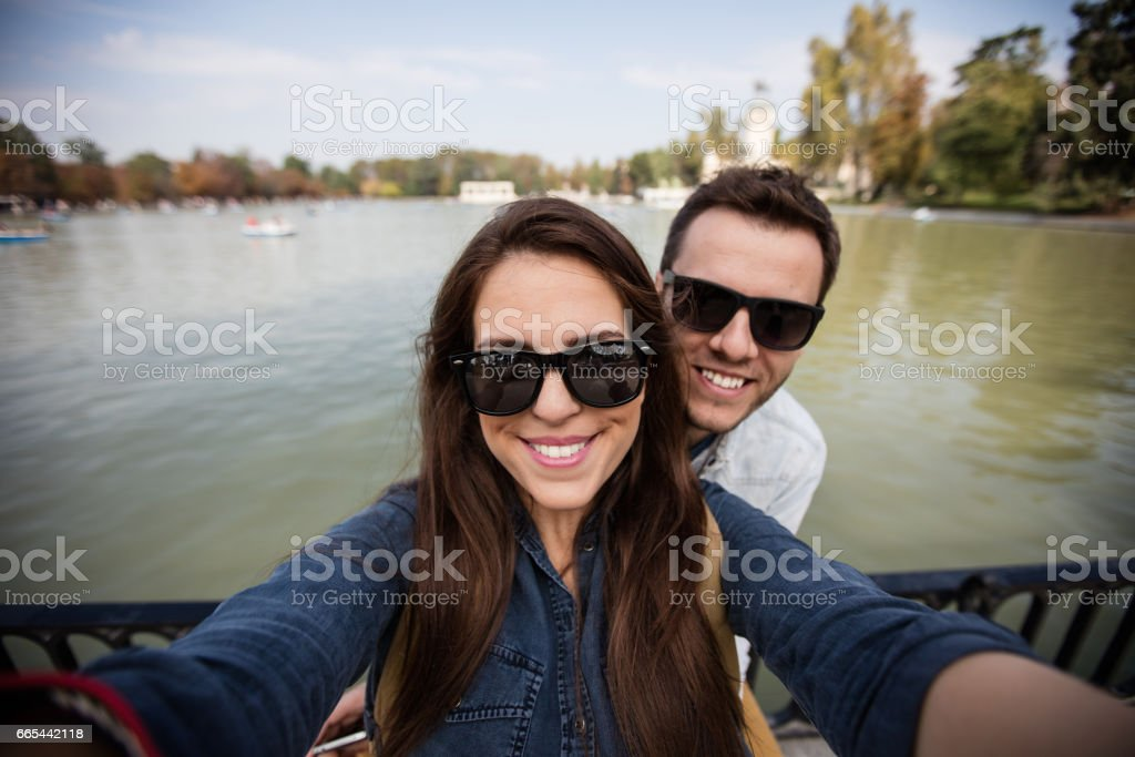 Cheerful young couple taking a selfie in Madrid stock photo