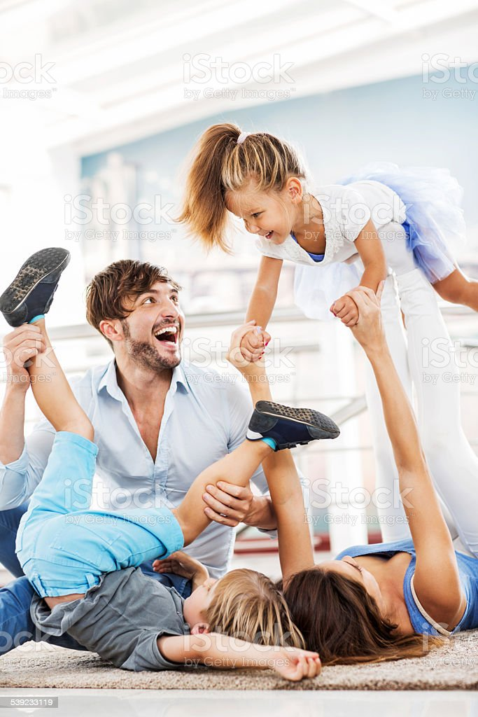 Cheerful young family having fun at home. royalty-free stock photo