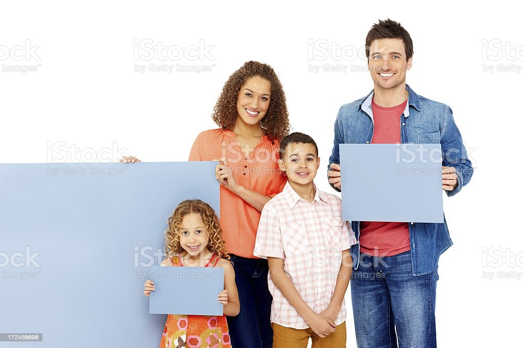 Cheerful young family holding empty banners against white royalty-free stock photo
