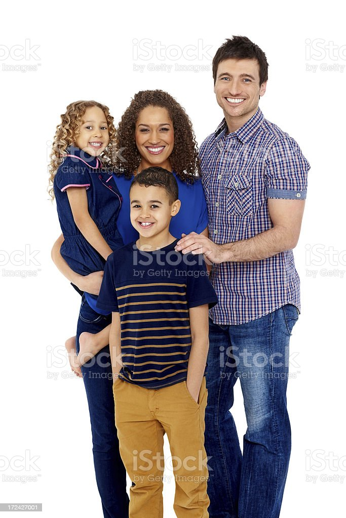 Cheerful young family of four together royalty-free stock photo