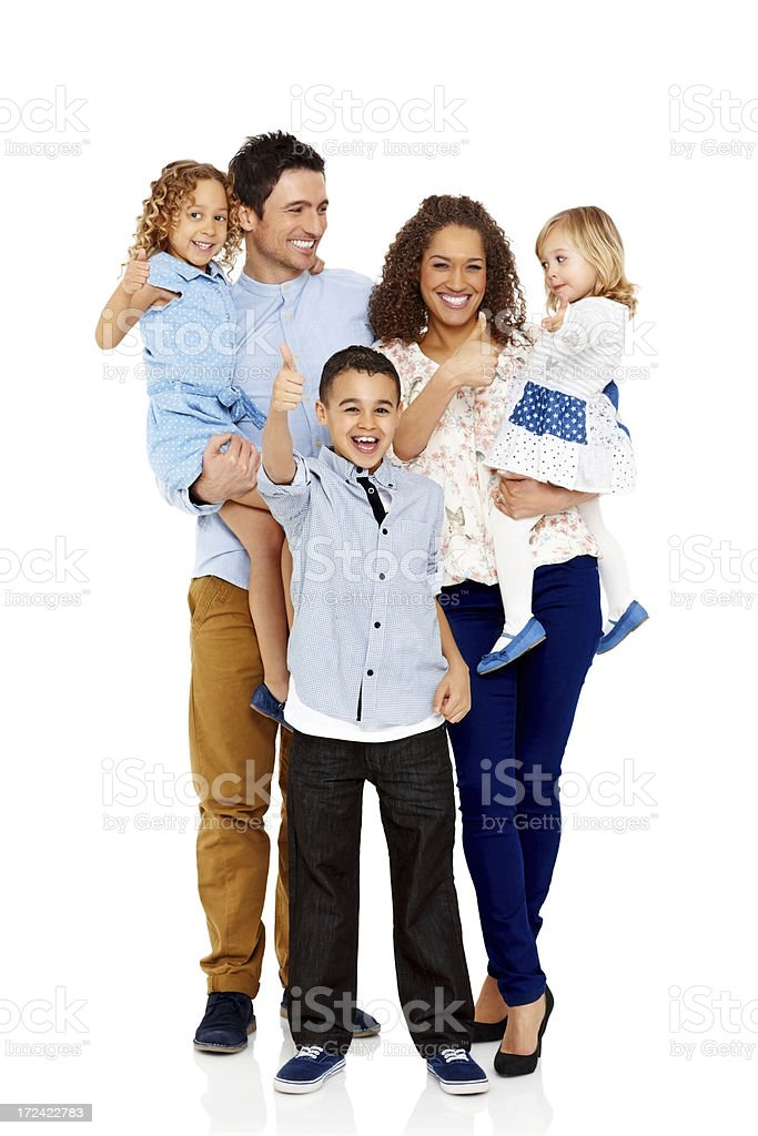 Cheerful young family showing thumbs up sign together royalty-free stock photo